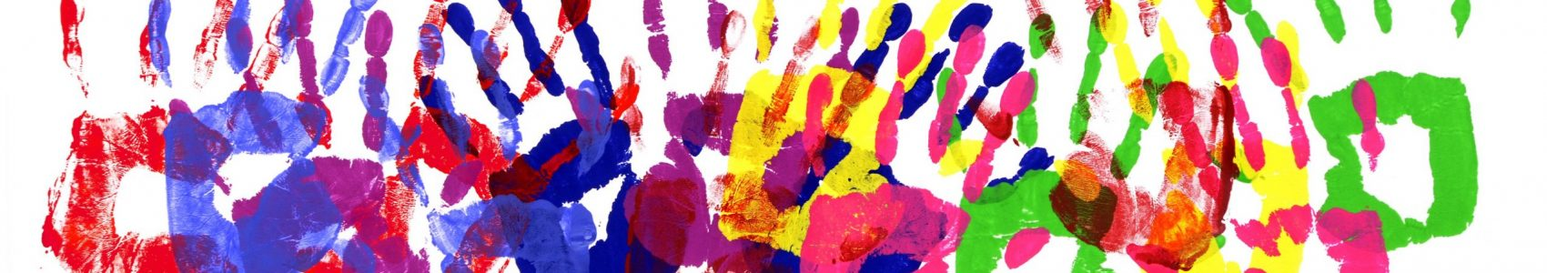 Horizontal border pattern of child handprints made from vivid acrylic paint isolated on a white paper background.
